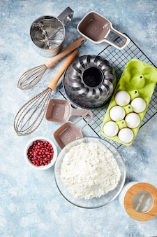 Baking ingredients and utensils, flour, eggs, baking dish