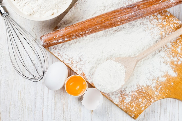 Baking ingredients on white wooden background. top view