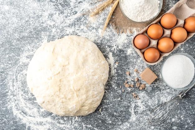 Baking ingredients with pressed yeast, eggs, sugar, milk, and flour
