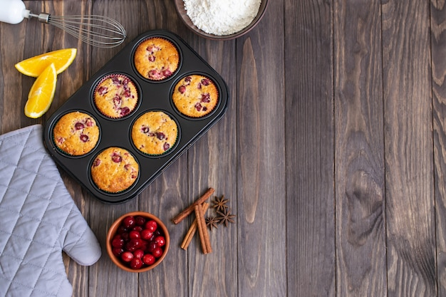 Baking muffins with cranberry