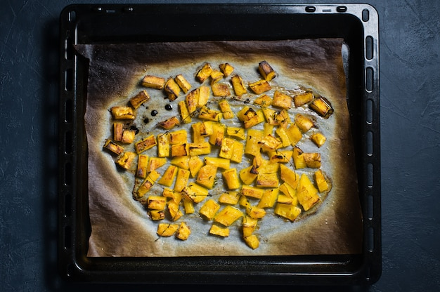 Baking pumpkin on a baking sheet.