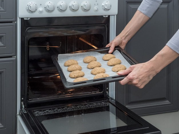 Baking sheet with cookies on the oven.