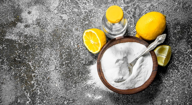 Baking soda with vinegar and lemon. Premium Photo