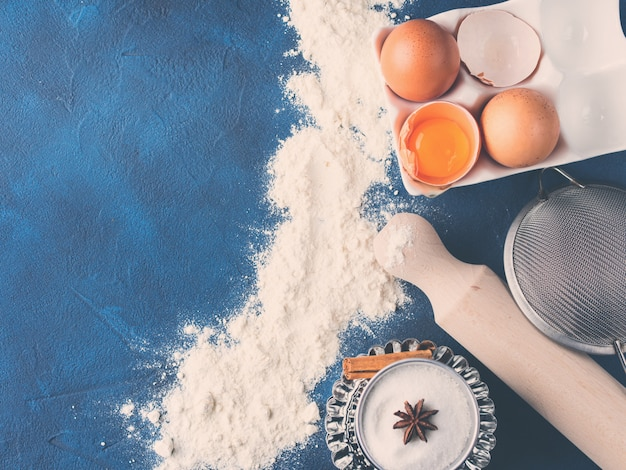 Baking tools rolling pin whisk and ingredients flour egg