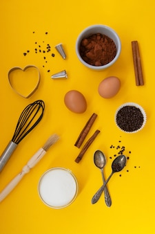 Baking tools on yellow background