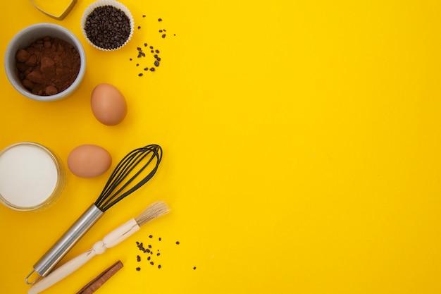 Baking utensils on yellow background