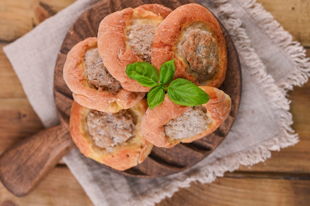 Baking with meat . high-calorie pastries for a delicious snack. traditional pastries from russia. rustic homemade food.
