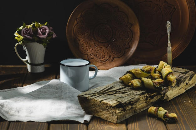 Baking with milk on a wooden table, rustic style