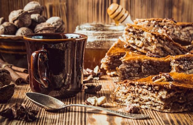 Baklava honey with walnuts. selective focus. food.