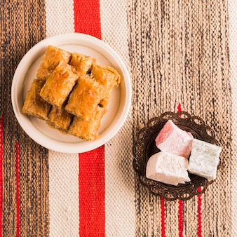 Baklava and turkish delights on saucers