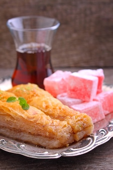 Baklava with walnuts and turkish delight with tea in turkish