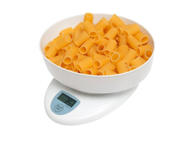 Balance scale with pasta