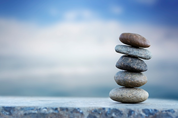 Balance stone with spa on blur sea background copy space for text