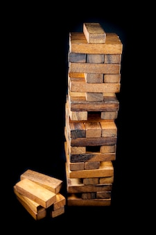 Balance tower wooden game on black background