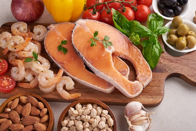 Balanced nutrition concept for clean eating flexitarian mediterranean diet top view flat. nutrition, clean eating food concept. diet plan with vitamins and minerals. salmon and shrimp, mix vegetables