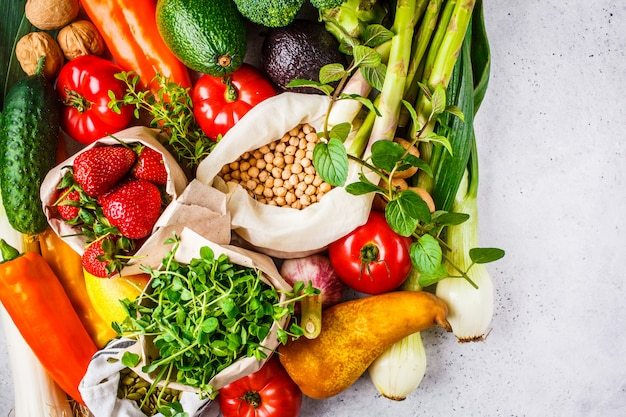 Balanced vegetarian food background vegetables, fruits, berries, nuts, sprouts, seeds, chickpeas