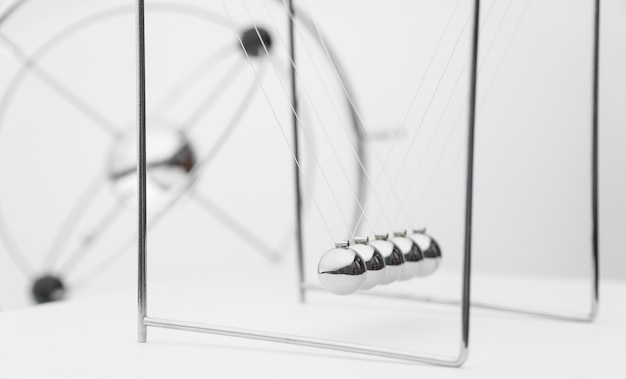Balancing balls on a white background. business concept. newtons cradle