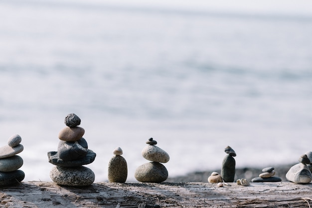 Balancing rocks on each other at the beach