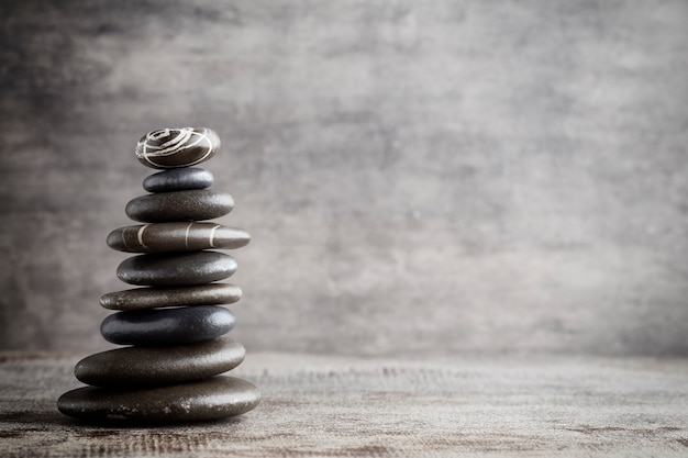 Balancing stones on the grey background.