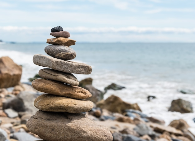 Balansed stacked stones on the beach