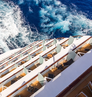 Balconies on a cruise ship, decks with wake or trail