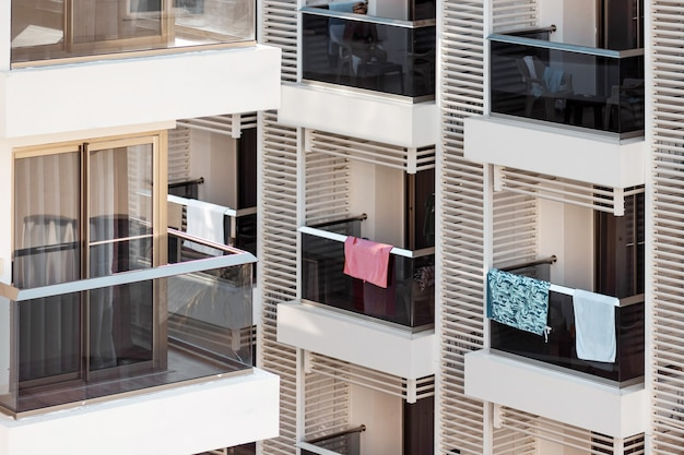 Balconies of the hotel rooms. glass balconies, on which towels hang.