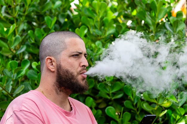 Bald and bearded man smoking