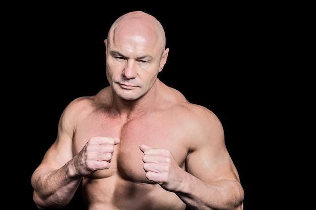 Bald man in boxing pose