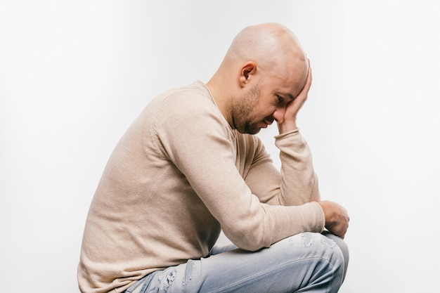 Bald man psychological stress struggling for life arter brain tumor. heartbreaking male emotions after cancer neurosurgery operation. oncology survivor patient. chemotherapy and irradiation head marks