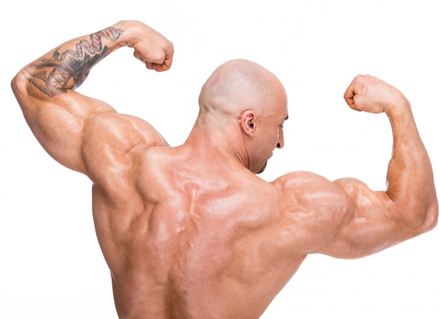 Bald man shows back muscles