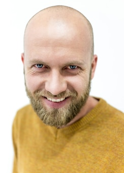 Bald young handsome man with blond beard smiling