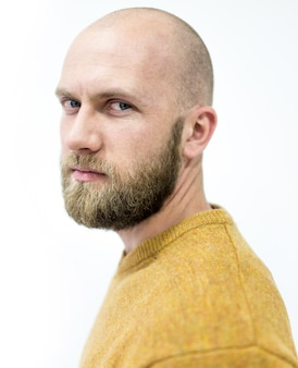 Bald young handsome man with blond beard