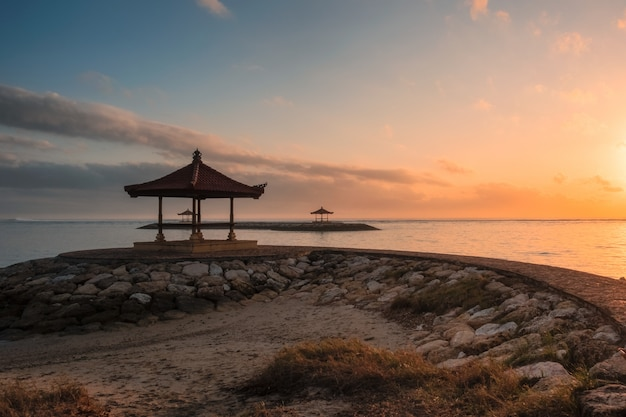 Bali pavilion on jetty at coastline in morning