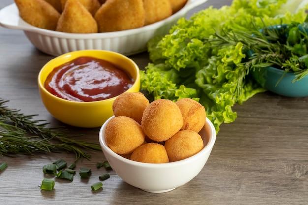 Ball cheese, coxinha of chicken, brazilian snack