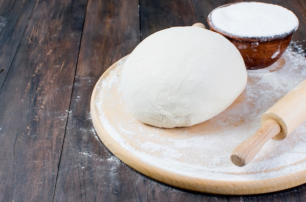 Ball dough , flour in a ceramik bowl