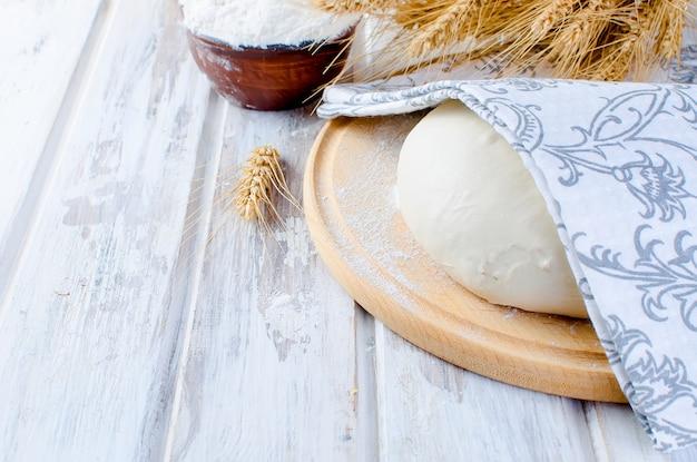 Ball dough , flour in a cermik bowl
