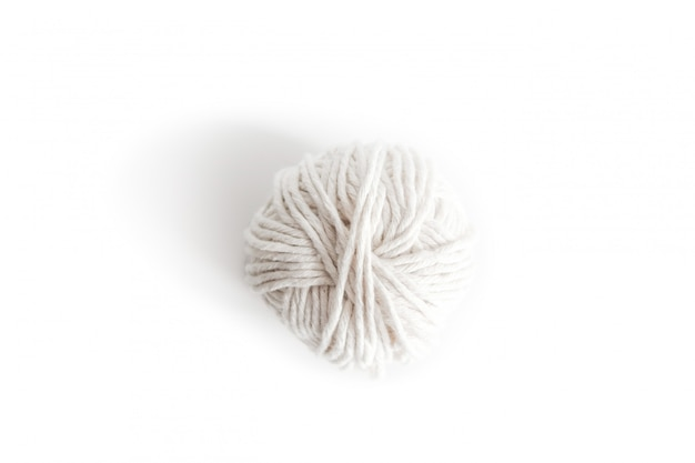 Ball of white yarn. isolated skein of wool boho logo