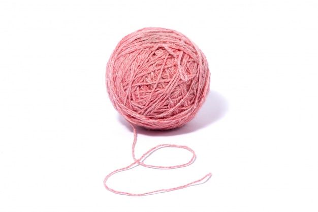 Ball of woolen pink thread isolated on white