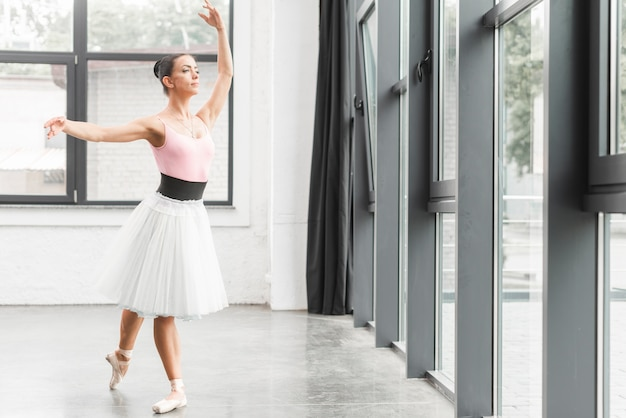 Ballerina dancing in beautiful rehearsal room