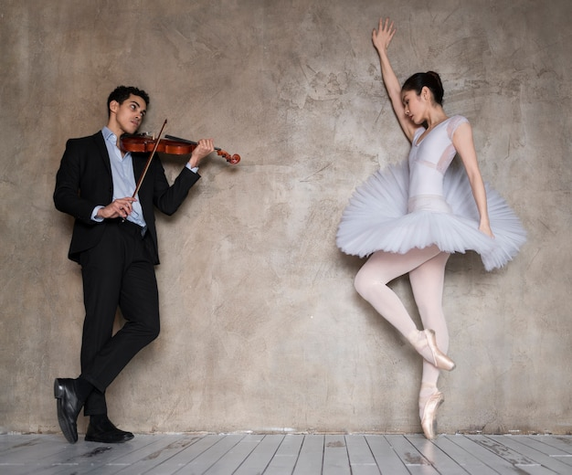 Ballerina dancing to music played by male musician