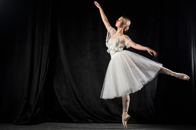 Ballerina dancing in tutu dress with copy space