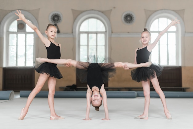 Ballerina girls stretching in dance class