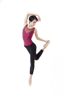 Ballerina is dancing on a white isolate