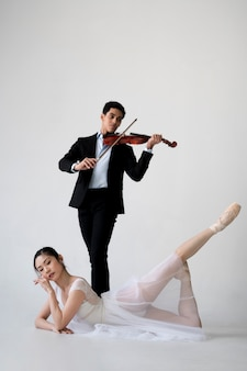 Ballerina and musician poising together