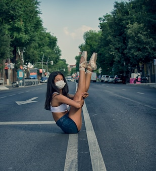 Ballerina on the road with pointshoes and mask