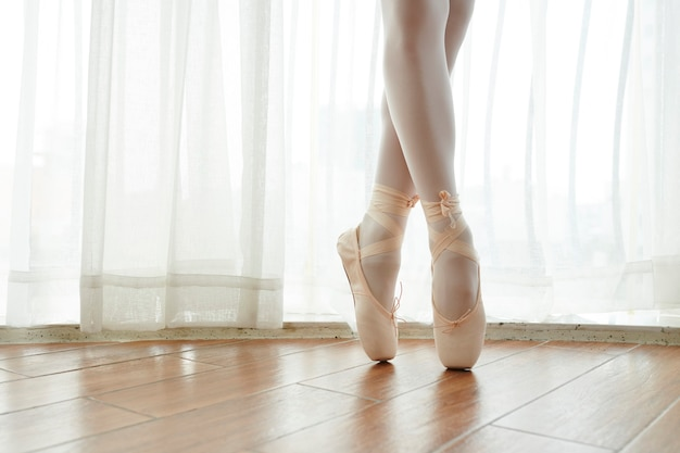 Ballerina standing on pointe shoes