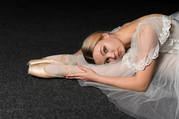 Ballerina in tutu dress stretching