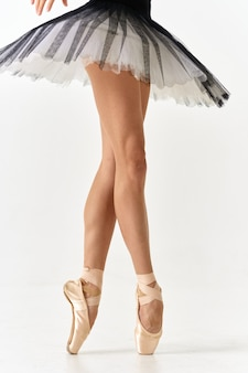 Ballerina in tutu and pointe shoes isolated