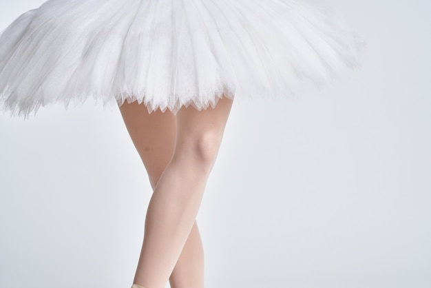 Ballerina white tutu dance exercise performance light background