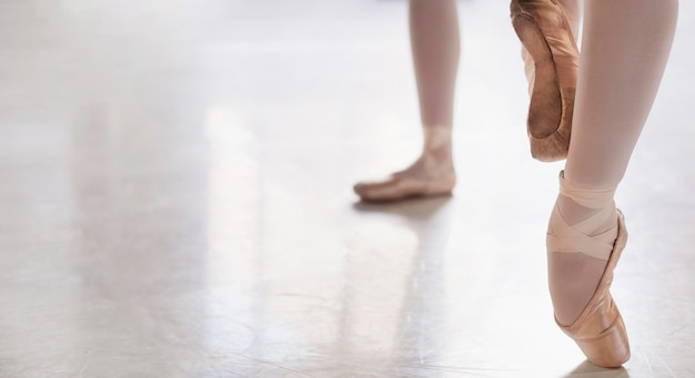 Ballerinas rehearsing in pointe shoes with copy space